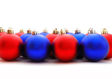 Christmas balls. Red and blue christmas balls on a white background Stock Images