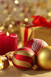 Christmas balls. And burning candles Royalty Free Stock Image
