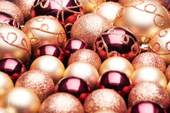Christmas balls. Purples and gold Royalty Free Stock Photos