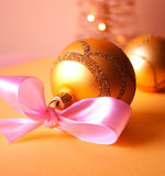 Christmas balls. Christmas decoration close-up with christmas balls and christmas tree in background royalty free stock photos