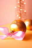 Christmas balls. Christmas decoration close-up with christmas balls and christmas tree in background royalty free stock photo