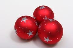 Christmas balls. Three red christmas balls with silver stars royalty free stock image