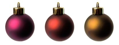 Christmas balls. Three different shades of christmas balls on isolated white background Royalty Free Stock Images