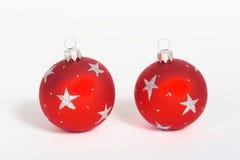 Christmas balls. Twored christmas balls with silver stars stock photos