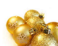 Christmas balls. Christmas gold balls with snowflakes on white background Stock Photography