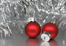 Christmas balls. Two red christmas balls on silver background Royalty Free Stock Photos