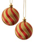 Christmas balls. Two stripy christmas balls isolated over white background royalty free stock photos