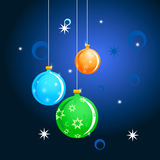 Christmas Balls. Three Christmas Balls blue background Royalty Free Stock Photos
