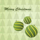 Christmas balls. On a green background Royalty Free Stock Photography