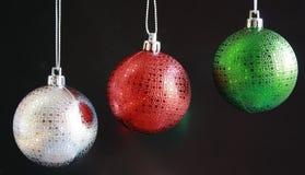 Christmas balls. Three green red and silver christmas balls hanging Stock Photography