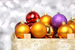 Christmas balls. Multicolored Christmas balls on blurred silver background royalty free stock image