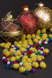 Christmas balls. Detail of Christmas balls with bows and gold spike balls against a plain background Royalty Free Stock Photography