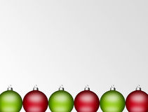 Christmas balls. Green and red christmas balls on empty background, space to insert text or design stock illustration