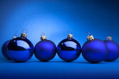Christmas balls. Photo of blue Christmas balls on a blue background Royalty Free Stock Photo