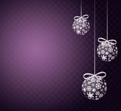 Christmas balls. Christmas scene with hanging ornamental purple xmas balls, snowflakes and stars Royalty Free Stock Photos