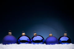 Christmas balls. Photo of blue Christmas balls on a blue background Royalty Free Stock Images