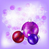 Christmas balls. On background with snowflakes and stars Royalty Free Stock Photo