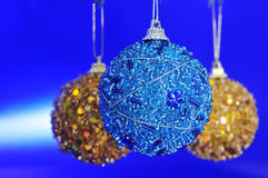 Christmas balls. Some christmas balls on a blue background royalty free stock images
