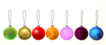 Christmas balls. Seven multi-colored Christmas balls with strings Royalty Free Stock Images
