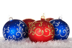 Christmas balls. With golden and silvery pattern on snow Royalty Free Stock Image