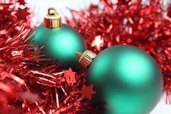 Christmas balls. Chistmas ornament, green balls and red tinsel Stock Photos