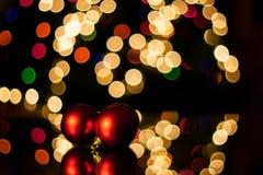 Christmas Balls. Red christmas balls with coloured bokeh Stock Photography