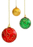 Christmas balls. Colorful Christmas baubles hanging, isolated on white background. Shallow DOF with red ball in focus royalty free stock images