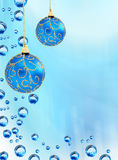 Christmas balls. Christmas baubles hanging on fresh blue background stock images