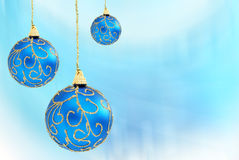 Christmas balls. Christmas baubles hanging on fresh blue background royalty free stock image