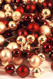 Christmas Balls. Strings of red and gold balls in a pile Stock Images