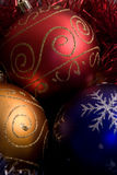 Christmas balls. Three christmas balls red blue and yellow Royalty Free Stock Photos