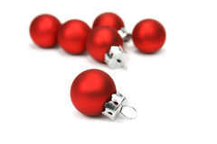 Christmas balls. Red christmas balls over white background Royalty Free Stock Image