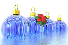 Christmas balls. Four blue Christmas balls in water and a Poinsettia flower Royalty Free Stock Photos