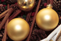 Christmas Balls. Shiny Gold Christmas balls and holiday decorations in a basket Stock Photos