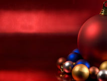 Christmas balls. On a metallic red background Stock Photography