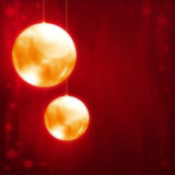 Christmas balls. Golden Christmas balls on a dark red background Royalty Free Stock Photography