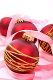 Christmas balls. And pink ribbon Royalty Free Stock Images