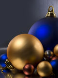 Christmas Balls. On a metallic blue background Stock Photos
