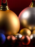 Christmas Balls. On a metallic red background Stock Photo
