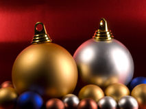 Christmas Balls. On a metallic red background Stock Image