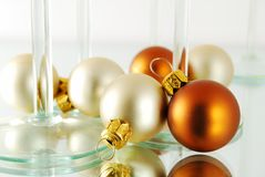 Christmas balls. A few christmas balls with glasses on the white background stock photo