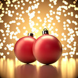 Christmas balls on abstract gold background. Close up Royalty Free Stock Images