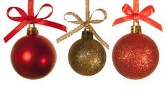 Christmas balls against white background. 3 christmas balls against a white background Royalty Free Stock Photos