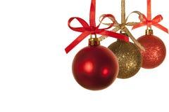 Christmas balls against white background. 3 christmas balls against a white background Royalty Free Stock Image