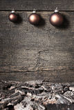 Christmas balls on aged wooden background Stock Photos