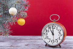 Christmas balls with an alarm clock and fir branches Stock Photography