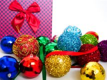 Christmas balls. Assortment of Christmas balls and and a present box on a table royalty free stock image