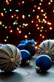 Christmas balls on the background lights. Stock Photos