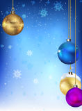 Christmas balls on the background of snowflakes. Blue background with falling snowflakes and Christmas balls Stock Images