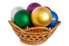 Christmas balls in basket. Varicoloured christmas balls on white background Stock Image